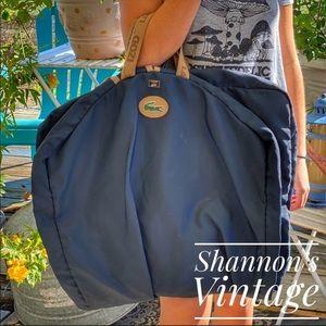 Vintage Lacoste Izod by Lark garment bag.
